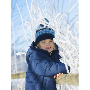Portrait of smiling  little boy outdoors on cold winter day